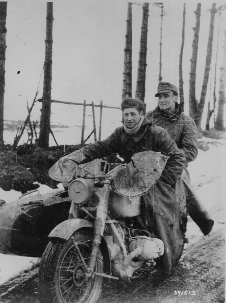 Elements of a Waffen SS reconnaissance company move through the Ardennes.