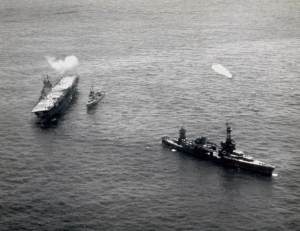 Heavy cruiser Northampton and a destroyer stand by to rescue the Hornet's crew and attempt to take her in tow during the afternoon of the battle.