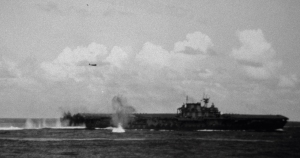 The Hornet under torpedo and dive bomb attack, October 26, 1942.