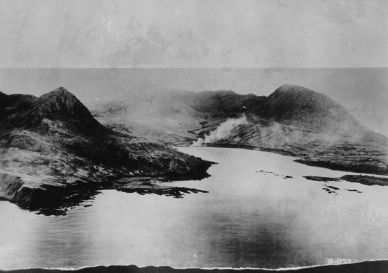 Japanese installations burn in Chicagof Harbor Attu just before the invasion
