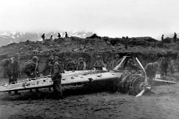 "Soldiers of the 7th Infantry Division examine a wrecked  Nakajima ""Rufe"" float plane fighter captured on Attu."