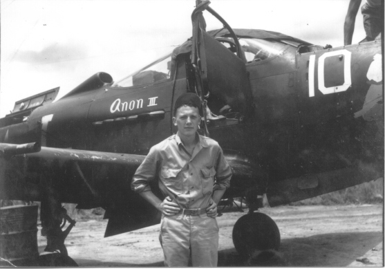Phil Shriver stands in front of his 40th Fighter Squadron Airacobra.