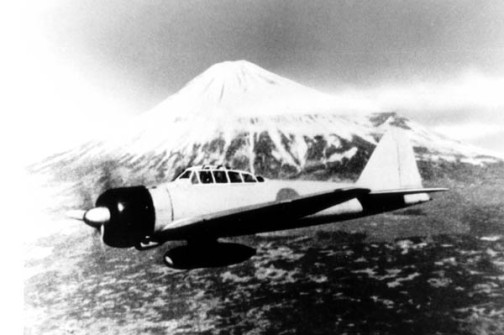A Mitsubishi A6M Zero over Mt. Fuji. The Zero proved a deadly adversary to the Americans piloting the P-39's and P-400's in defense of Port Moresby.