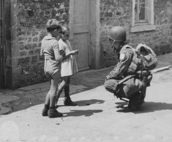 101st Airborne Div Paratrooper with french children normandy dday 060844  (1 of 1)