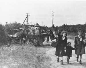 1st Army Front Knocked Out German panzer jaeger Marder II with French Female Refugee Civilians Normandy France 061244  (1 of 1)
