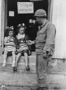 1st Army NCO hands out candy to french kids during 4th of July in La Mine France 070444  (1 of 1)