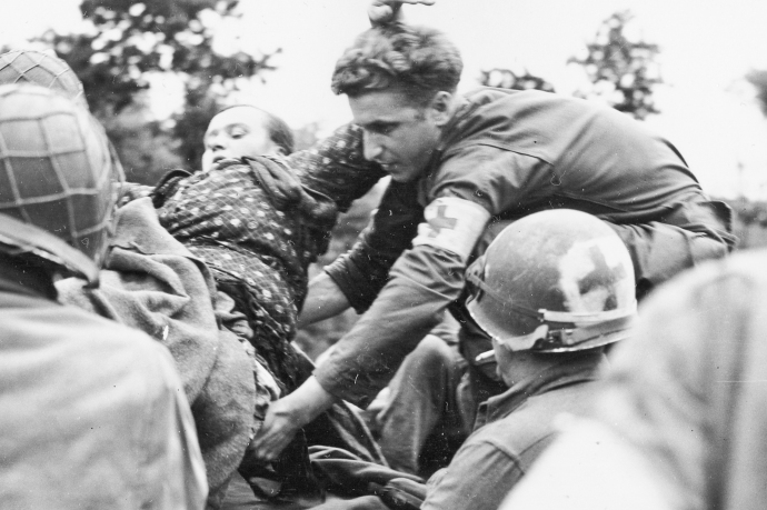 79th Inf Div 1st Army CASEVAC French Woman with legs blown off by mine Medics treating her  Fierville France Normandy Campaign 070844 (1 of 1)