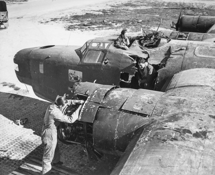 A badly damaged British Liberator, seen here back in England after it had been struck by a falling bomb dropped from a squadron mate in mid-flight. The British largely used their Liberators as long-range anti-submarine and maritime patrol aircraft.