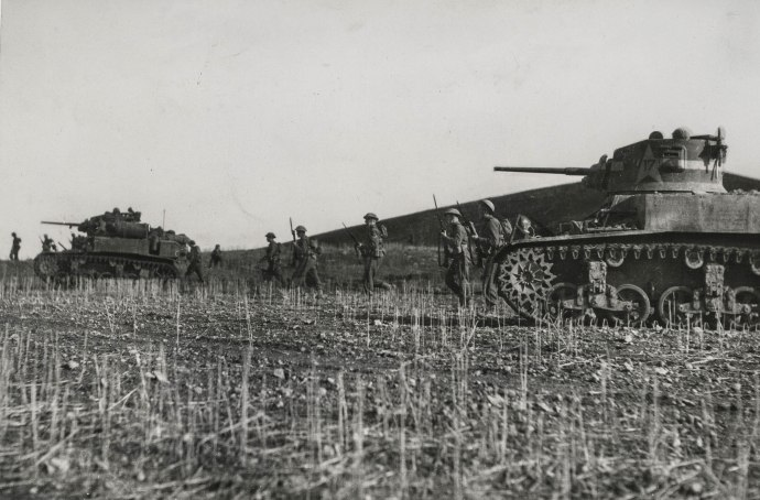 US Army WWII Series M3 Stuart light tanks support Biritsh Army infantry Tunisia prolly 1943-1