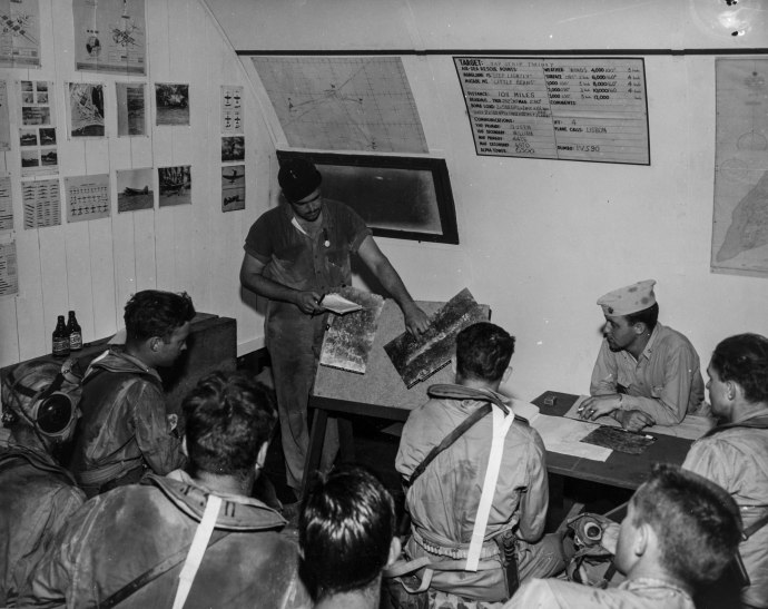 VMSB-245 crews receive a target briefing prior to a mission against Yap Island on May 1, 1945.