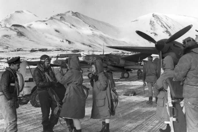 Men of the 54th Fighter Squadron greet a group of Army nurses on Attu Island during the winter of 1943-44.