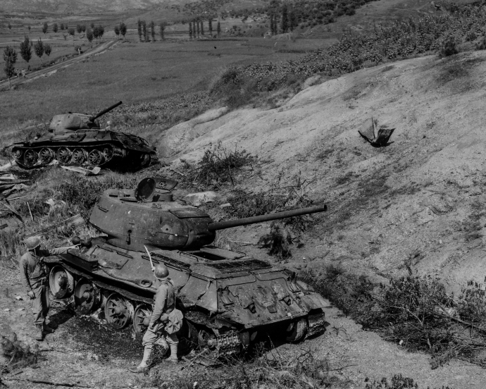Men of the 1st Provisional Marine Brigade examine knocked out North Korean T-34 tanks during the 2nd Battle of the Naktong River, September 4, 1950.