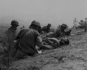 Corpsmen work on a wounded Marine during the 2nd Battle of the Naktong River, September 3, 1950.