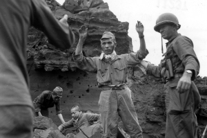 Men of the 147th capture a Japanese hold out on Iwo Jima during their three month long ordeal on the volcanic island.