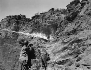 147th Inf Regt Flame Thrower Attack on Japanese Cave Iwo Jima Bonin Islands 040845 (1 of 1)