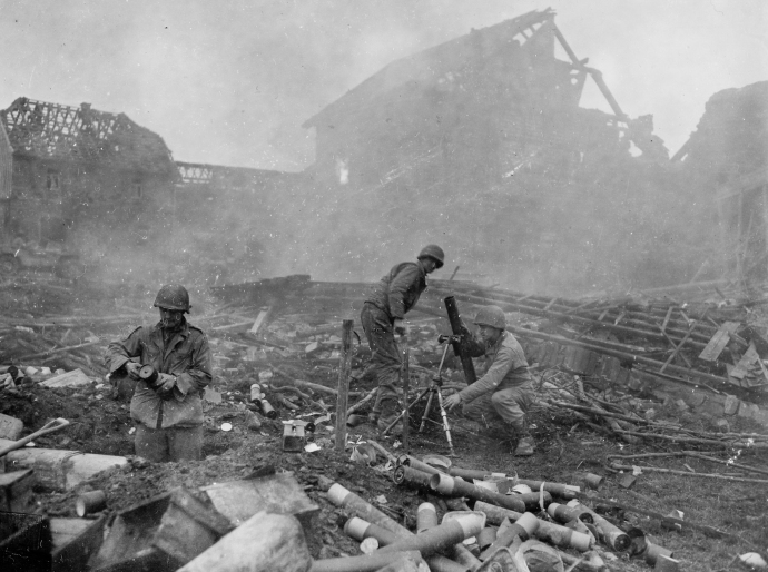 On of the 22nd Infantry's 81mm mortar crews firing in support of the rifle companies holding off a German counter-attack at Grosshau on December 1, 1944.